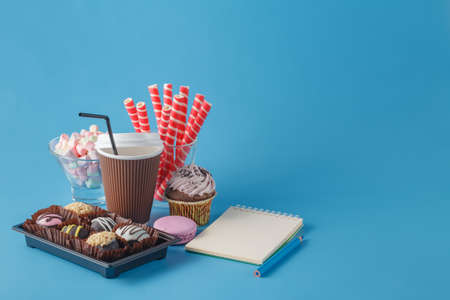 takeout: take-out coffee with cup holder and sweets Stock Photo