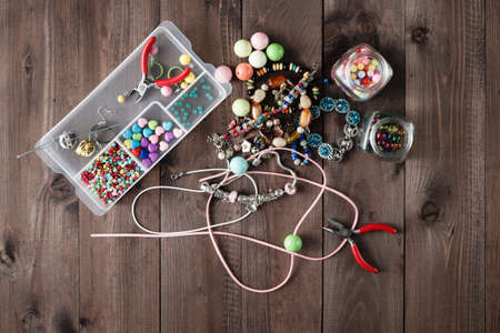accessory for making home craft art jewellery layout on wooden table