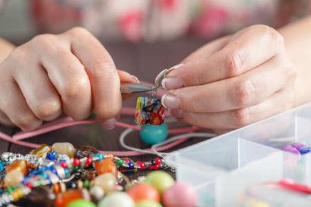 Woman making home craft art 写真素材