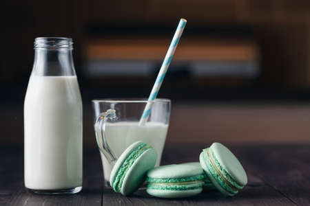 jag: milk glass with cookies on rustic wooden table with copy space