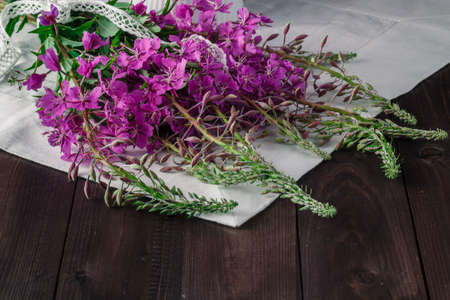fireweed: Fireweed flowers fresh on a wooden boards background. Copy space Stock Photo