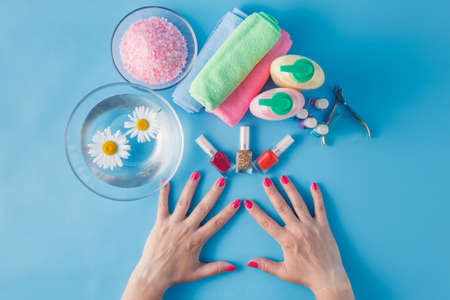 laque: Spa hands accessories on plain blue background