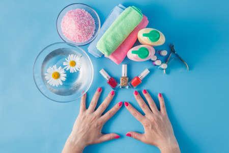 laque: Spa hands accessories on plain blue background
