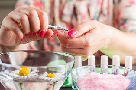 cuticle: manicure applying, cutting the cuticle with scissors Stock Photo