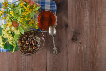 complementary: linden flowers, herbal therapy. Cup of healthy linden tea with honey. folk, alternative, complementary medicine, Stock Photo