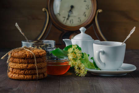 linden blossom: Healing herbal tea with Linden blossom and cookies Stock Photo