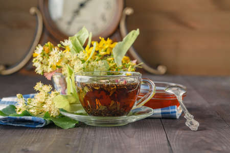 linden tea: linden flowers, herbal therapy. Cup of healthy linden tea with honey. folk, alternative, complementary medicine, Stock Photo