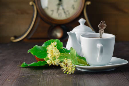 linden blossom: Herbal tea cup with Linden blossom on wooden table