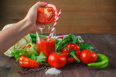 juicing: Juicing tomato juice in glass on the kitchen table