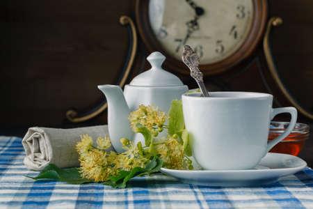linden flowers: linden flowers, herbal medicine, Cup of healthy linden tea with honey. Stock Photo