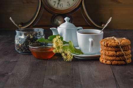linden blossom: Breakfast with cookies and  tea cup, Linden blossom on wooden table