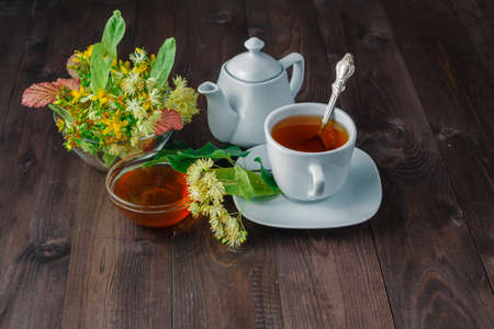 linden blossom: Healing tea with herbs and linden blossom Stock Photo