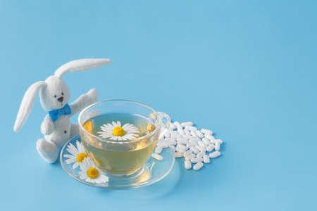 chamomile tea: Child medicine chamomile tea and toy rabbit Stock Photo
