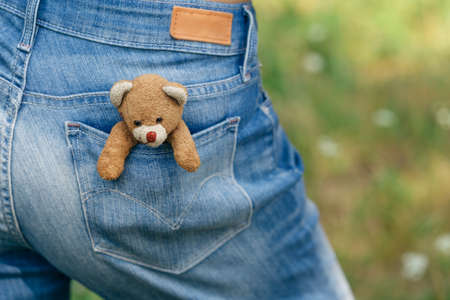 playthings: Teddy-bear in a pocket of jeans