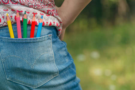 Denim pocket with colored pencils Stock Photo