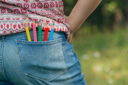 denim: Denim pocket with colored pencils Stock Photo