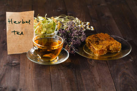 Herbal tea with honey recipe on table