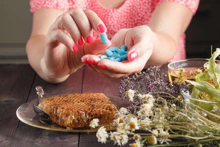 alternative health: Alternative health care herbs and herbal capsule in woman hands