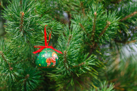 pine needles close up: Christmas ball on a background of a natural fir-tree