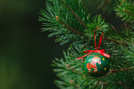 toygift: part of decorated Christmas tree with balls closeup
