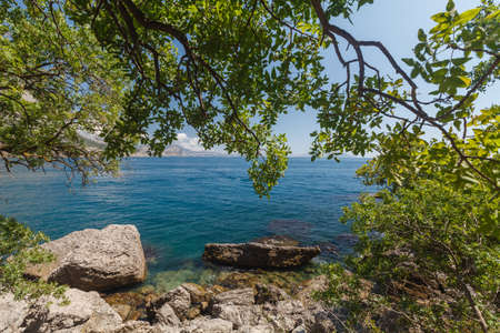 secluded: Secluded beach with turquoise sea water Stock Photo