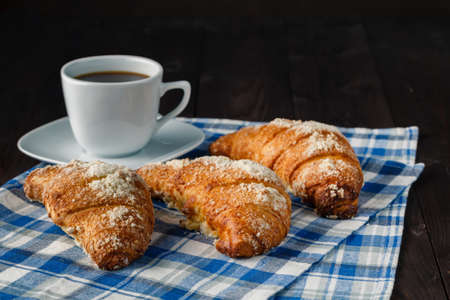 crema: Breakfast with coffee crema, milk, fresh croissants on vintage on wooden background