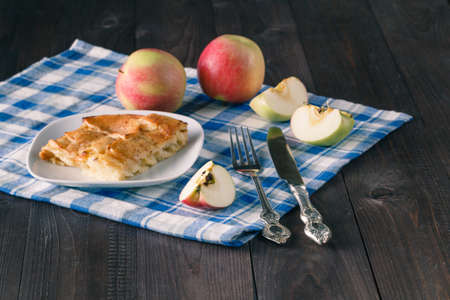 Creamy Apple Pie on wood background