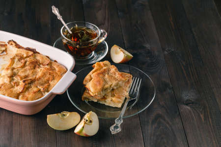 Apple strudel or apple pie with dates and cinnamon Stock Photo