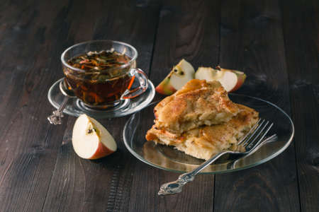 atmosphere: Home made apple pie with apples and cinnamon. Evening Christmas atmosphere