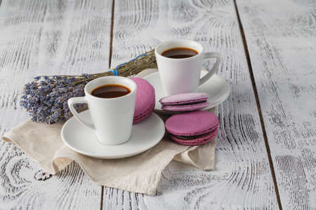Aroma coffee cups with lavender on saucer