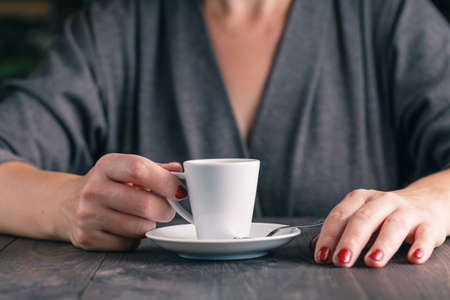 Close up photo of hands and cup of coffee