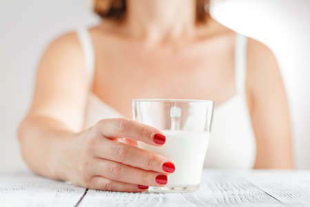 Milk - Woman drinking milk Stock Photo