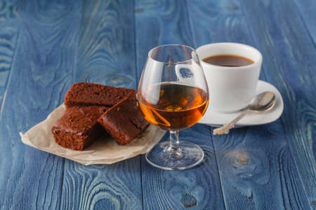 chocolaty: Breakfast with freshly brewed coffee and brownie on the wooden table natural background Stock Photo