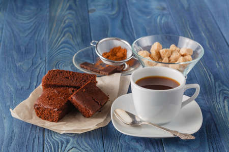 fudge: Chocolate fudge brownie with cup of espresso coffee