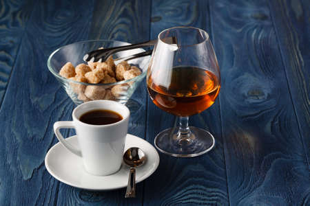 happyhour: Close up a glass of cognac and coffee Stock Photo