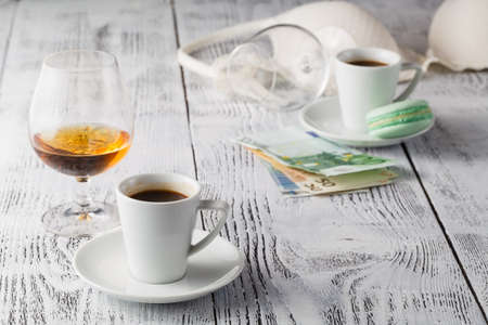 afternoon cafe: Two cups of coffee on restaurant terrace with afternoon sunlight Foto de archivo