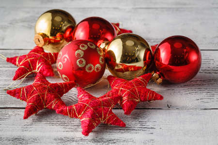 red christmas ball: Christmas Decoration Over Wooden Background Stock Photo