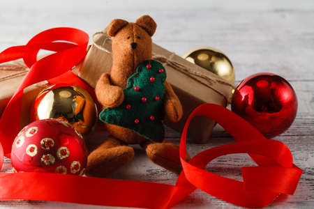 compostion: Christmas compostion in red and gold on a white background: