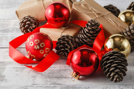 metier: Pine and spruce cones and red christmas balls. Christmas decoration