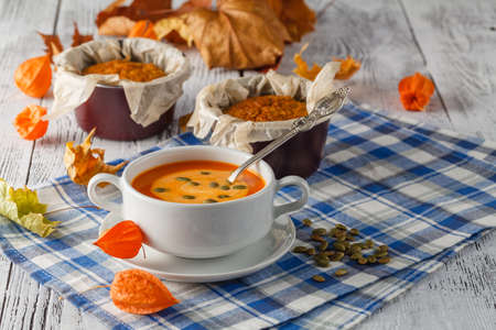 butternut: Homemade Autumn Butternut Squash Soup with Bread Stock Photo