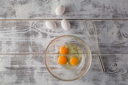 albumen: Eggs in a bowl with whisk