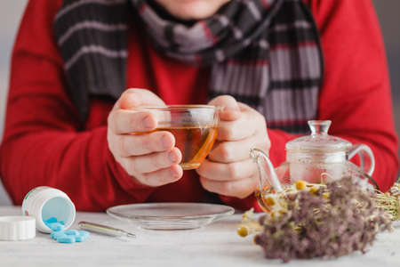 rheum: Male with rheum holding a cup of hot tea