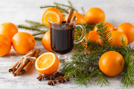 Christmas mulled wine with oranges and pine tree