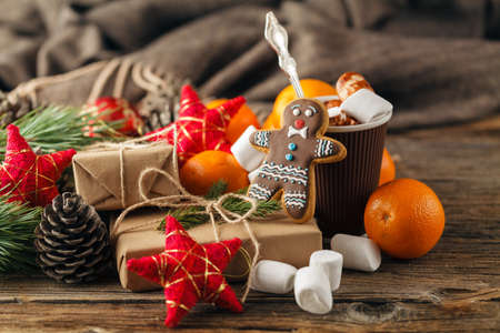 Christmas gingerbread cookies with festive decoration and hot chocolate. Holiday concept Stock Photo