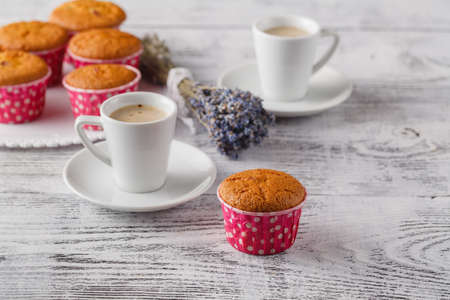 Dcelicious lavender muffins with fresh flowers Stock Photo