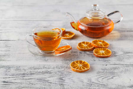 DIY winter composition with dried orange, tea glass 版權商用圖片