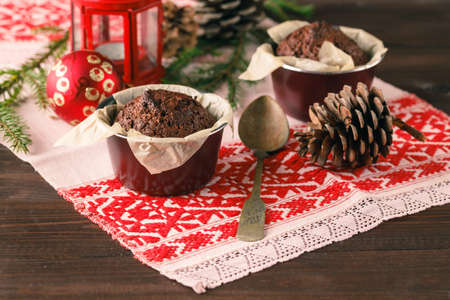 banana bread: Two muffins, chocolate muffin and cinnamon muffins - sweet food on a rustic wooden table