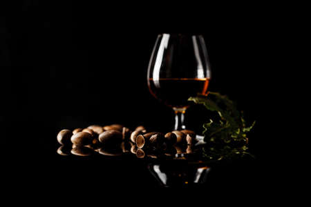 sherry glasses over a dark background with plenty of copy space and oak