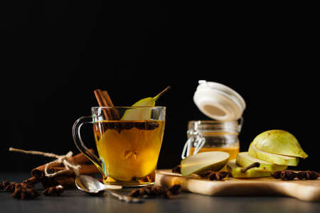 Pear Ginger punch with spices on dark stone surface Stock Photo - 68907453