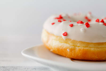 Single donut on white plate